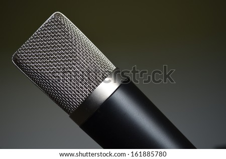black and silver steel mesh audio microphone - stock photo
