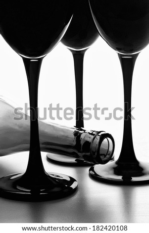 Black and white abstract wine glassware background design. - stock photo