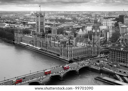 Black and White Aerial view of the Houses of Parliament with selective colour red london Buses - stock photo