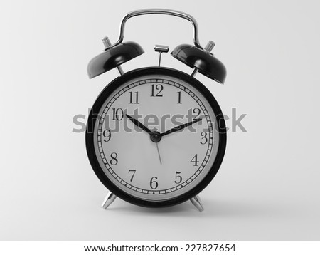 black and white antique alarm clock isolated