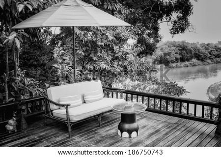 black and white armchairs and river  view on the Terrace