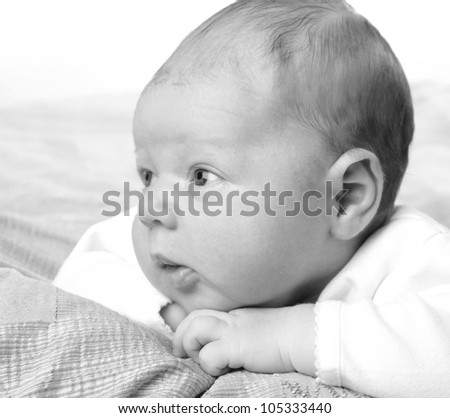 Black and white Art photo of lovely caucasian newborn boy