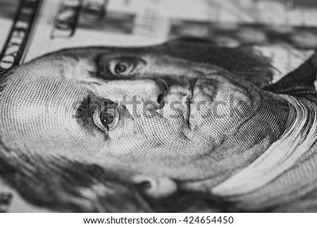 black and white art photography monochrome, background of the money, hundred dollar bills front side. close up macro, Portrait of Benjamin Franklin on the hundred-dollar bills - stock photo