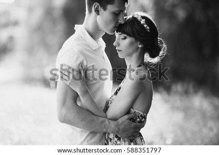 Black and white art photography monochrome, loving couple in the birch forest. Man and woman walking on nature. Hugging each other. Be happy.