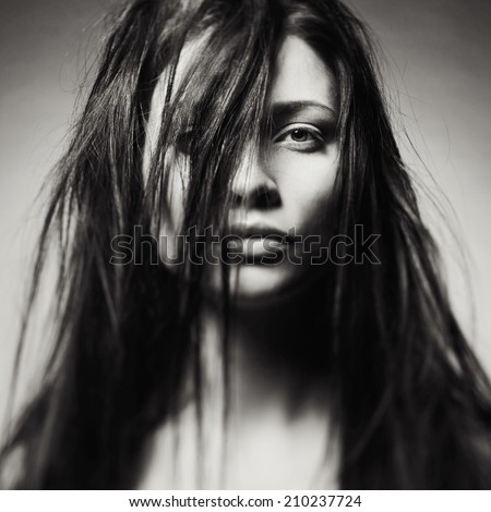 Black and white art portrait of a beautiful young lady - stock photo