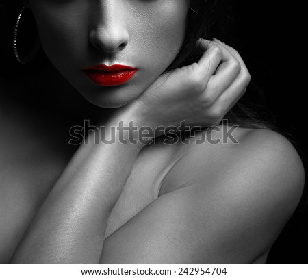 Black and white art portrait of sexy woman with red glossy lips on dark. Closeup - stock photo