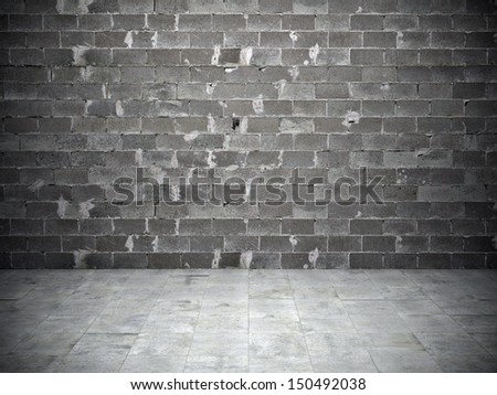 Black and white background of brick wall and stone floor - stock photo