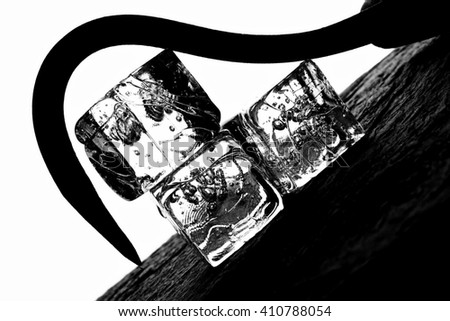 Black and white background  photo of ice cubes and hook. - stock photo