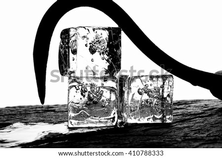 Black and white background  photo of ice cubes and hook.