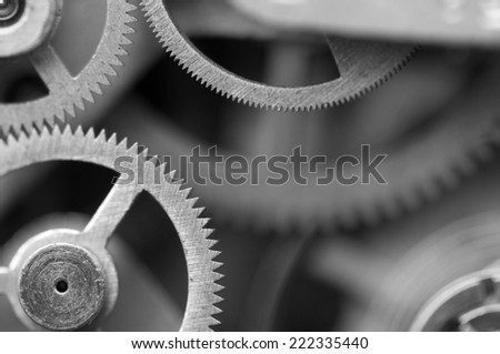 Black and white background with metal cogwheels a clockwork. Conceptual photo for your successful business design. Macro - stock photo