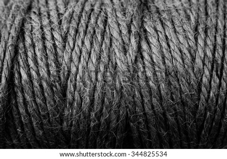 black and white background woven jute rope, close-up - stock photo