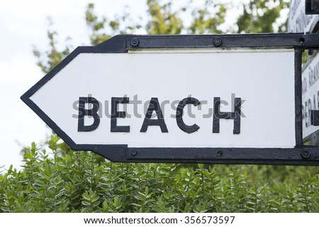 Black and White Beach Direction Sign