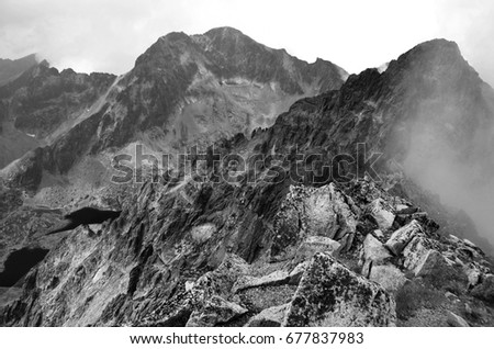 Black and white beautiful foggy mountains landscape of scottish highlands rough texture background