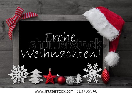 Black And White Blackboard With Red Santa Hat And Christmas Decoration like Snowflake, Tree, Christmas Ball, Fir Cone, Star. German Text Frohe Weihnachten Means Merry Christmas. Wooden Background - stock photo