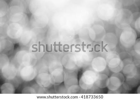 Black and white blurred bokeh - stock photo