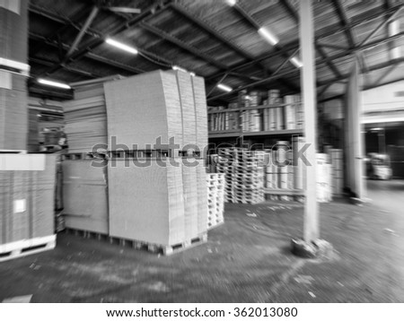 Black and white blurred view of paper mill factory interior. Industrial concept.