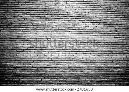 Black and White Brick Wall Background with Highlighted Center - stock photo