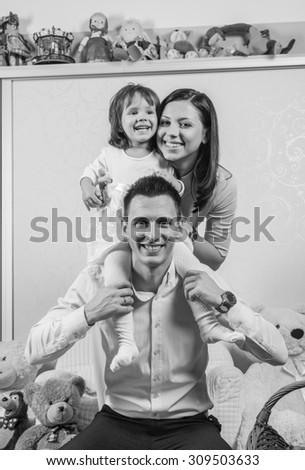 Black and White. BW. Family portrait with mother father and daughter