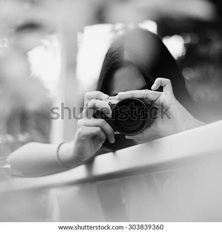 Black and white camera girl - stock photo
