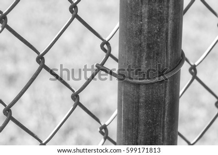 black and white chain link fence post