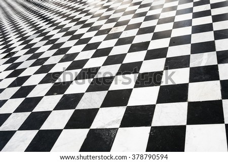 Black and white checkered abstract indopor floor pavement, black and white image - stock photo