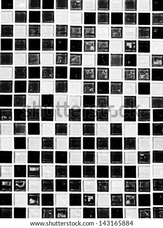 Black and white checkered tiles texture - stock photo