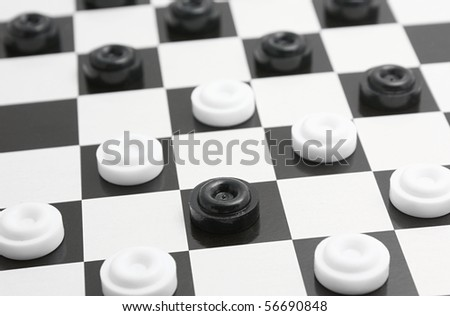Black and white checkers on playing field