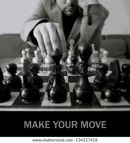 black and white chess concept with man make move- space for sample text - stock photo