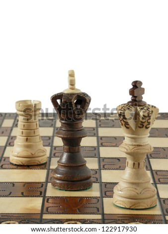 Black and white chess figures on chess desk - stock photo