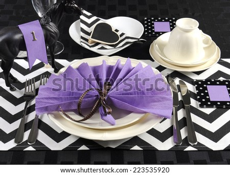 Black and white chevron with purple theme party luncheon table place setting for Melbourne Cup, Australian public holiday, horse race event - stock photo
