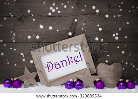 Black and White Christmas Card With Purple Christmas Decoration On White Snow, Snowflakes. Picture Frame. German Text Danke Means Thank You, Star, Heart, Christmas Ball.Rustic Wooden Background - stock photo