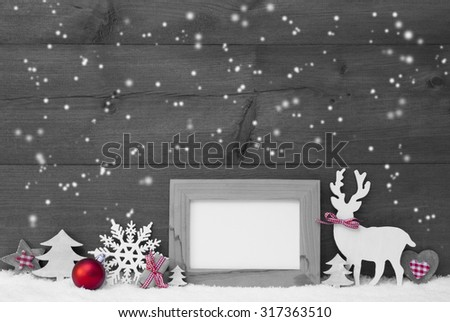 Black And White Christmas Decoration.Empty Picture Frame Reindeer Christmas Trees Snowflakes Red Ball On Snow. Christmas Card For Seasons Greetings.Copy Space For Advertisement. Wooden Background - stock photo