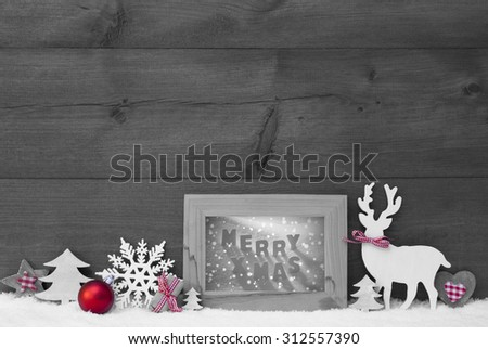 Black And White Christmas Decoration With Reindeer Christmas Trees Snowflake Red Ball On Snow. Picture Frame With English Text Merry Xmas. Christmas Card For Seasons Greetings. Wooden Background - stock photo