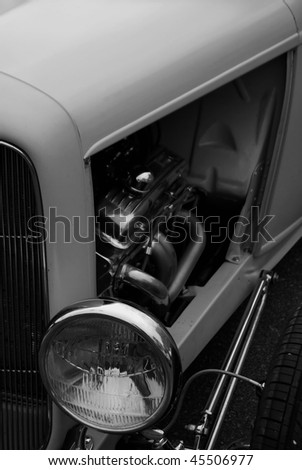Black and white close-up detail of a classic vintage automobile. - stock photo