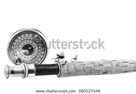 Black and White Close up of lure  fly fishing, rod and reel on white background - stock photo