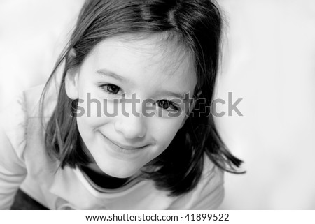 Black and white close up of smiling little girl
