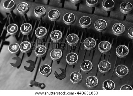Black and white close-up of vintage manual typewriter keys with shallow depth of field effect  - stock photo