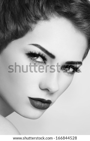 Black and white close-up portrait of beautiful woman with stylish make-up  - stock photo