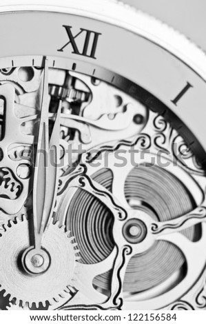 black and white close view of watch hands and mechanism - stock photo
