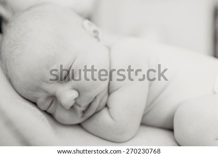 Black and white closeup image of a newborn baby sleeping
