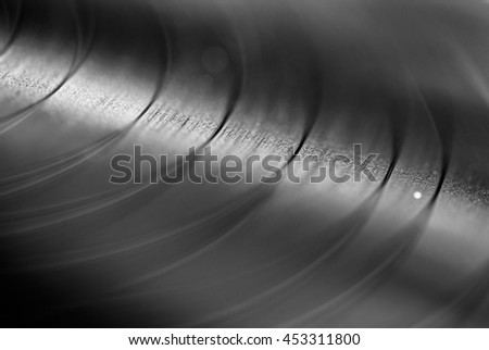 Black and white closeup macro photos of textures and pattern of vinyl record,LP for background as abstract with toned color and selective soft focus or blurred - stock photo