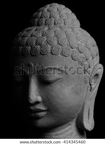 Black and white closeup picture of Buddha's face