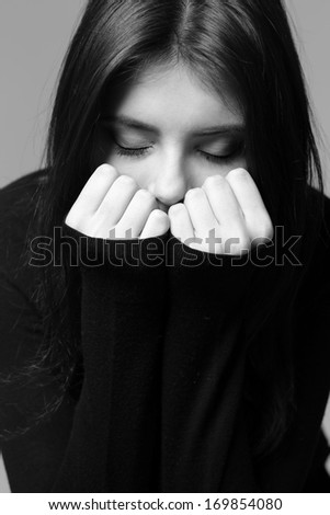 Black and white closeup portrait of a nervous woman - stock photo