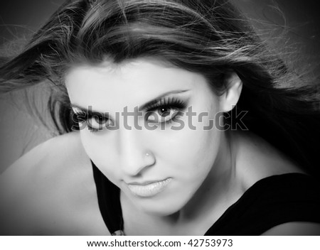 Black and white closeup portrait of young woman with beautiful eyes