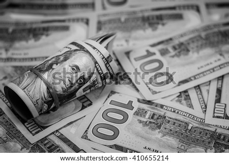 Black and white color of one hundred American dollar currency,money,Focus on eye of Franklin - stock photo