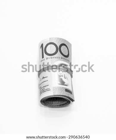 Black and white color One hundred dollars Australian notes roll on white background - stock photo