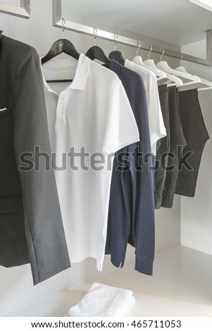 black and white color tone clothes in modern white wardrobe