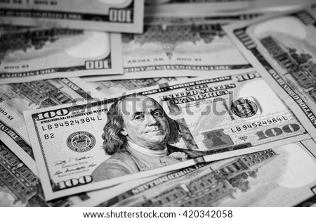Black and white color with background and texture of one hundred american dollar currency,money.Focus on eye of Franklin - stock photo