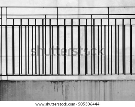 black and white corridor with fence