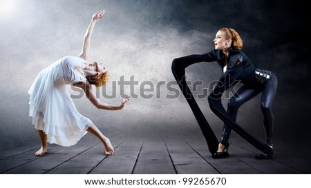 Black and White Dancers in posing on background (on the photo - one person, one model release) - stock photo